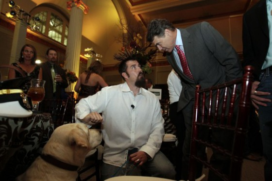 Rick Perry Talks With Retired US Navy SEAL Marcus Luttrell Shown Luttrells Dog Rigby Before Addresses The Lone Survivor Foundations Second
