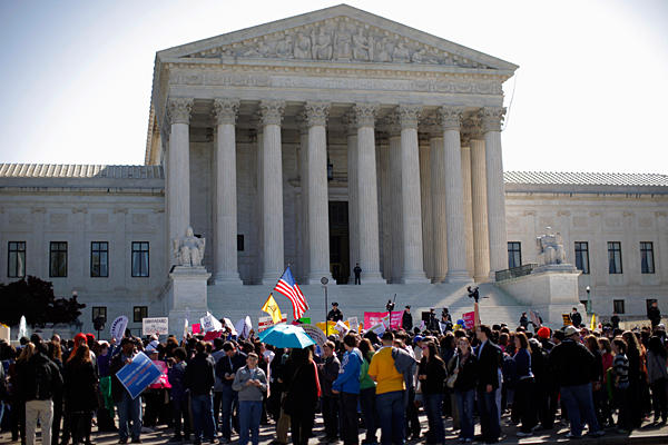opponents of health-care reform rally in front of the Supreme Court ...